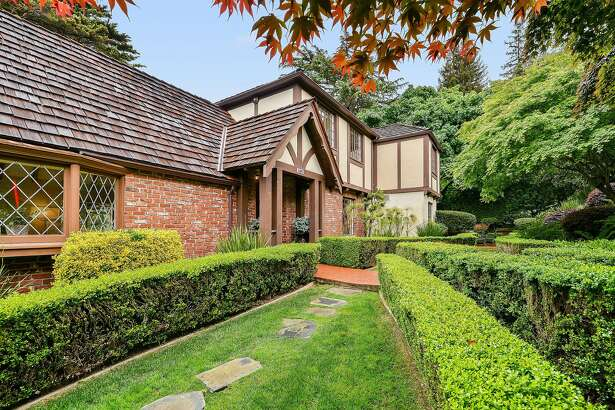 Lattice windows accent the brick and stucco facade of this English country home in Upper Rockridge.
