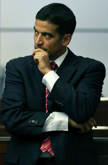 Bexar County District Attorney Nicholas LaHood listens to an audio tape as he makes closing arguments in the 437th State District Court, in the case against Jessie Hernandez Jr. on Tuesday, August 11, 2015, who is accused of shooting two police officers. Photo: Bob Owen, Staff / San Antonio Express-News / San Antonio Express-News
