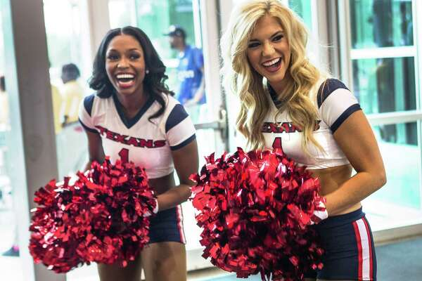 Houston Texans cheerleaders greet fans at the door during the Texans draft party at NRG Stadium on Thursday, April 28, 2016, in Houston.