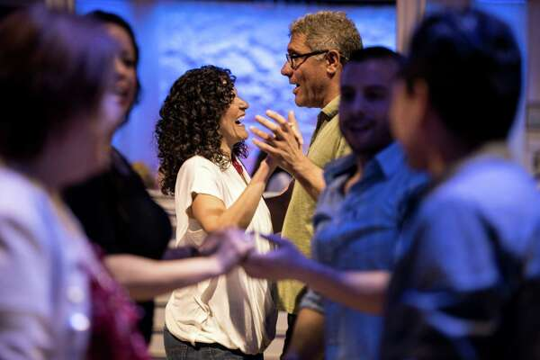 Waleska Williams, of Stamford, and Juan Sosa, of Greenwich, take a salsa dancing lesson from Lou Lopez at the Palms nightclub in Stamford. Lopez runs the lesson every Thursday.