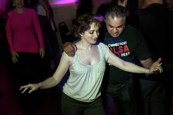 Lou Lopez, owner of Latin Moves Dance Studio in Stamford, dances with Yevgeniya Shinsky, of Rye Brook, N.Y., at The Palms nightclub in Stamford.