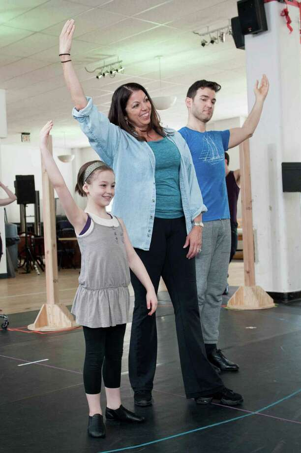"Choreographer Peggy Hickey rehearses a number from the new musical ""Anastasia"" with Nicole Scimeca and Constantine Germanacos. The show by the writers and composer of ""Ragtime"" will play Hartford Stage May 12 to June 19. Photo: Contributed Photo / Defining Studios"