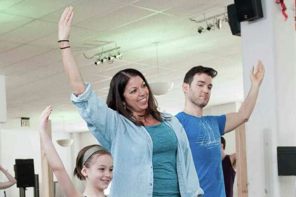 "Choreographer Peggy Hickey rehearses a number from the new musical ""Anastasia"" with Nicole Scimeca and Constantine Germanacos. The show by the writers and composer of ""Ragtime"" will play Hartford Stage May 12 to June 19."