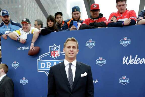 California's Jared Goff poses for photos upon arriving for the first round of the 2016 NFL football draft at the Auditorium Theater of Roosevelt University, Thursday, April 28, 2016, in Chicago.