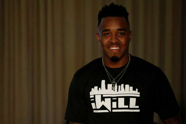 """University of Houston's William Jackson wearing an """"iWill"""" t-shirt during his NFL Draft party at the Westin Oaks in the Galleria, Thursday, April 28, 2016, in Houston."""
