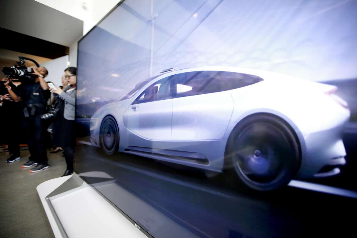 LeEco's 120-inch, 3D 4K Ultra HD TV displays video of the company's electric concept car during the opening ceremony of LeEco's North American headquarters in San Jose. The company, a major presence in China, is virtually unknown here. (Photo by Tony Avelar/Invision for LeEco/AP Images)