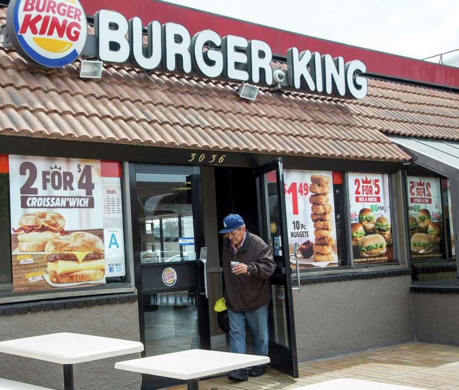 FILE - In this Wednesday, March 18, 2015, file photo, food specials are offered at a Burger King fast food restaurant in Los Angeles. On Thursday, April 28, 2016, Burger King owner Restaurant Brands International Inc. reports earnings. (AP Photo/Damian Dovarganes, File) ORG XMIT: NYBZ404 Photo: Damian Dovarganes / Copyright 2016 The Associated Press. All rights reserved. This m