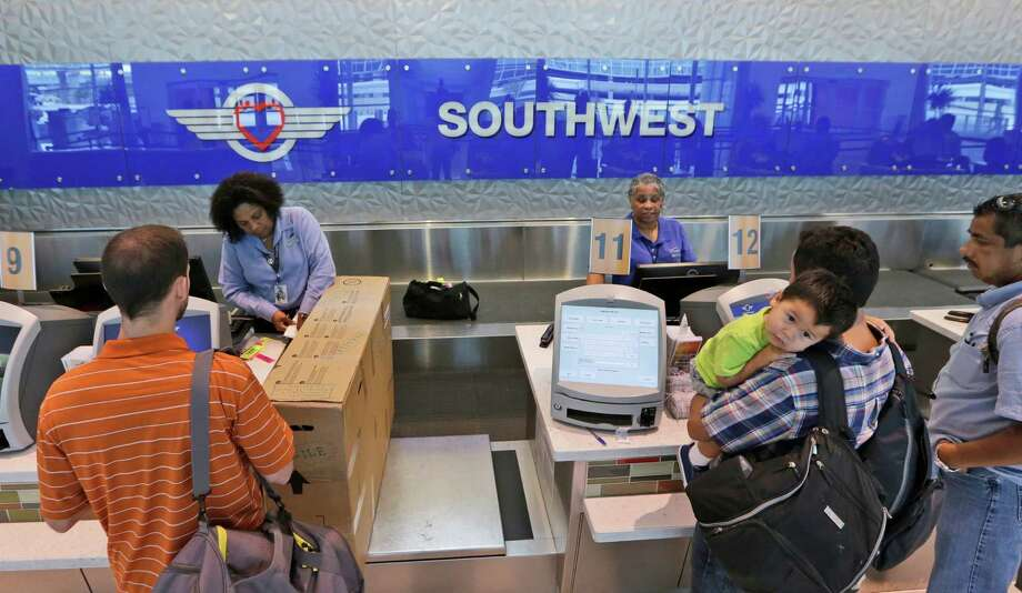 FILE - In this June 5, 2014, file photo, travelers check in at a Southwest Airlines ticket counter at Love Field in Dallas. Southwest Airlines caught rivals and Wall Street by surprise when it cut many U.S. fares by $5 each way, applicable to tickets bought within seven days of departure. Meanwhile, Delta Air Lines was busy raising fares on domestic routes by $5 each way. And it did not match Southwest's lower fares where the two carriers compete, a Delta spokesman said Thursday, April 28, 2016. (AP Photo/LM Otero, File) ORG XMIT: NYBZ427 Photo: LM Otero / Copyright 2016 The Associated Press. All rights reserved. This m
