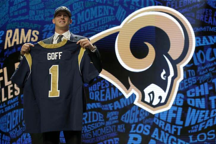 California's Jared Goff poses for photos after being selected by the Los Angeles Rams as the first pick in the first round of the 2016 NFL football draft, Thursday, April 28, 2016, in Chicago. (AP Photo/Charles Rex Arbogast)
