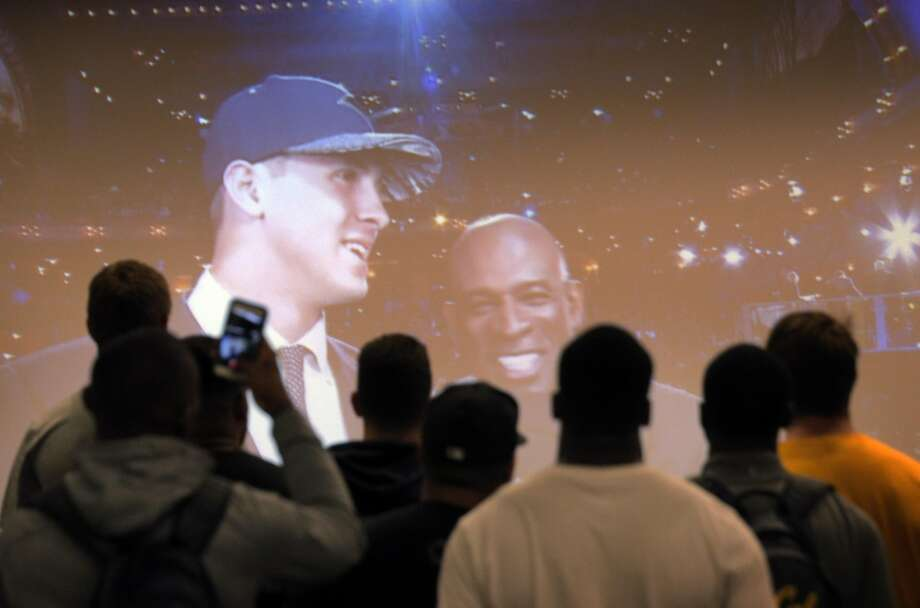 Teammates of Cal quarterback Jared Goff watch Goff interviewed by Deion Sanders after Goff was selected first overall in the 2016 NFL draft by the Los Angeles Rams as they watched at Memorial Stadium in Berkeley, Calif., on Thursday, April 28, 2016. Photo: Carlos Avila Gonzalez, The Chronicle