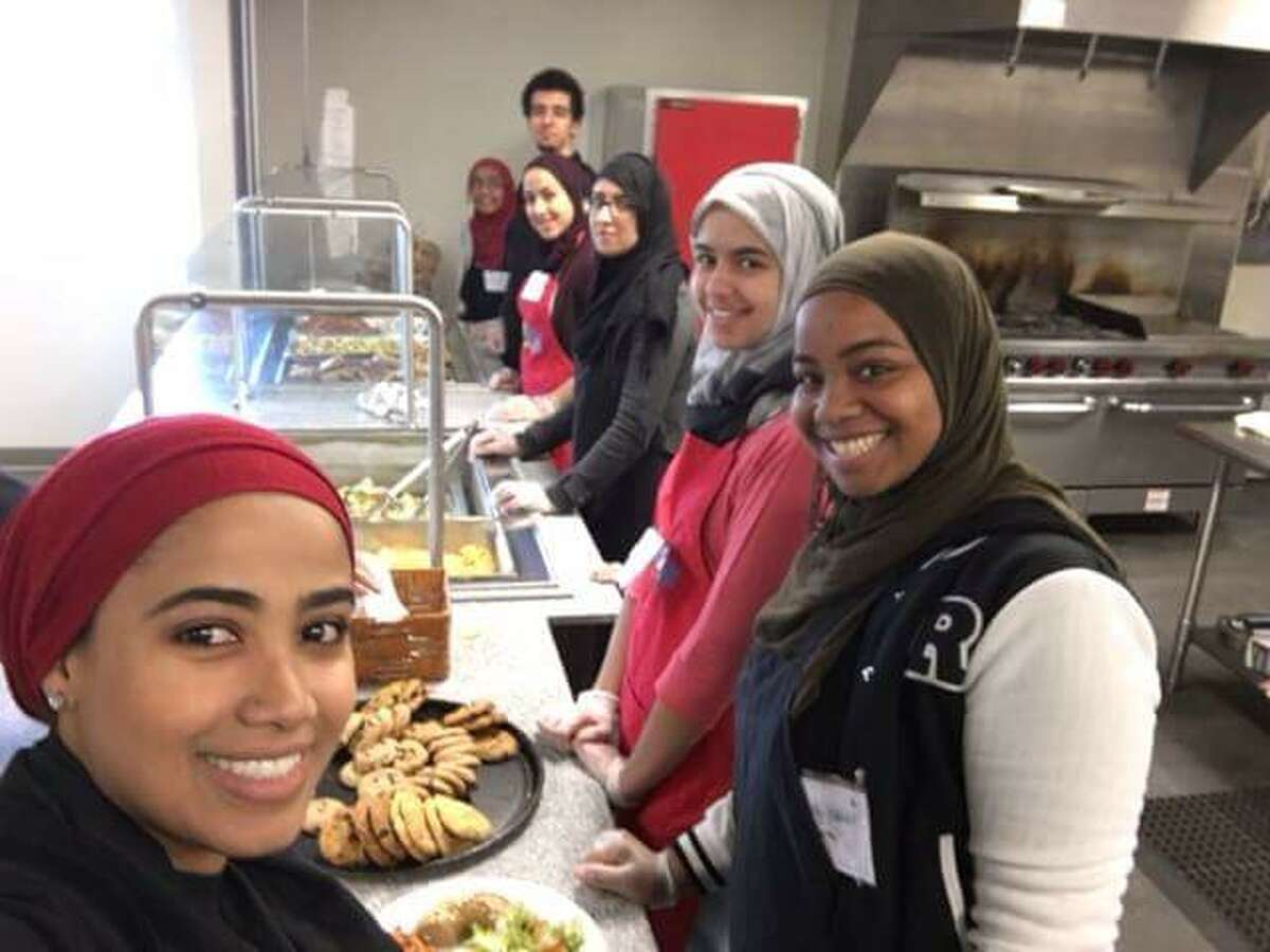 Volunteers with the Muslim Soup Kitchen Project prepare a meal for local homeless and needy people in this 2015 photo. They will participate in the inaugural National Muslim Soup Kitchen Day on Saturday at nine local sites. (Photo courtesy of Uzma Popal)