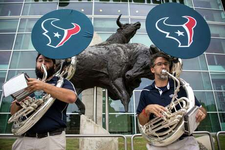 The Houston Texans pep band performs outside NRG Stadium before the Texans draft party on Thursday, April 28, 2016, in Houston.