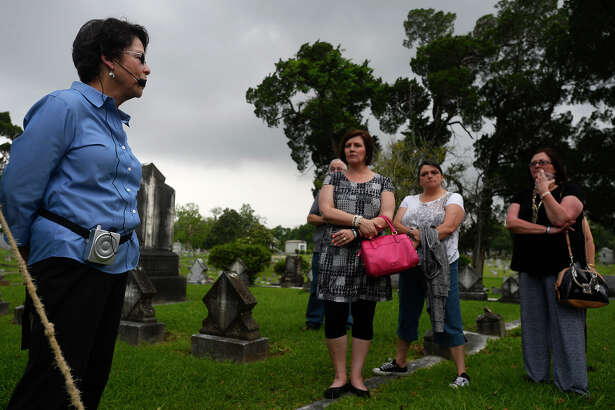 Judy Linsley talks to guests about some of the interred during the Heritage Happy Hour at Magnolia Cemetery on Thursday evening. Guests learned about some of the cemetery's interred while strolling through the grounds.  Photo taken Thursday 4/28/16 Ryan Pelham/The Enterprise