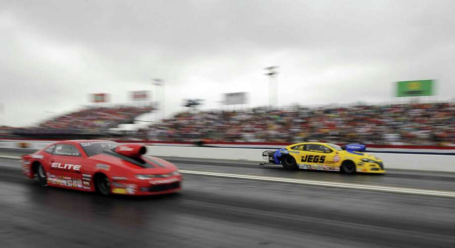 The cars of Erica Enders-Stevens, left, and Jeg Coughlin Jr. are different this season after changes that include replacing carburetors with fuel injectors and getting rid of the bulbous hood scoops. Photo: Eric Christian Smith, Freelance