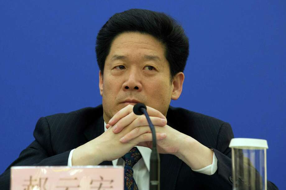 Han Yunhong, an official from the Public Security Bureau listens to questions during a press conference about a law regulating overseas non-governmental organizations held at the Great Hall of the People in Beijing, China, Thursday, April 28, 2016. China passed a much-debated law on foreign non-governmental organizations on Thursday in a move in which Beijing says would better serve the groups but critics are concerned would further restrict them by subjecting them to close police supervision. (AP Photo/Ng Han Guan) Photo: Ng Han Guan, STF / Copyright 2016 The Associated Press. All rights reserved. This material may not be published, broadcast, rewritten or redistribu