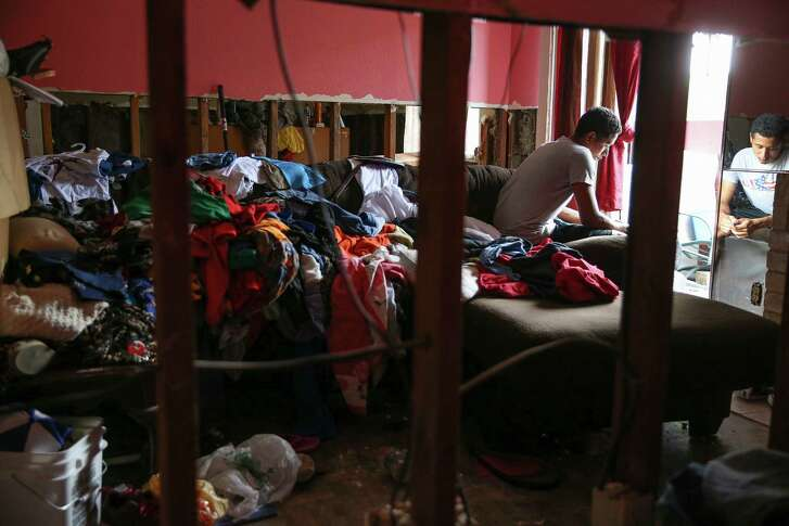 Flooding damaged the Maison de Ville unit where Marvin Moradel Ruiz lives with his mother and siblings.