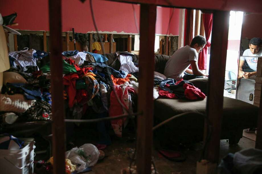 Flooding damaged the Maison de Ville unit where Marvin Moradel Ruiz lives with his mother and siblings. Photo: Elizabeth Conley, Staff / © 2016 Houston Chronicle