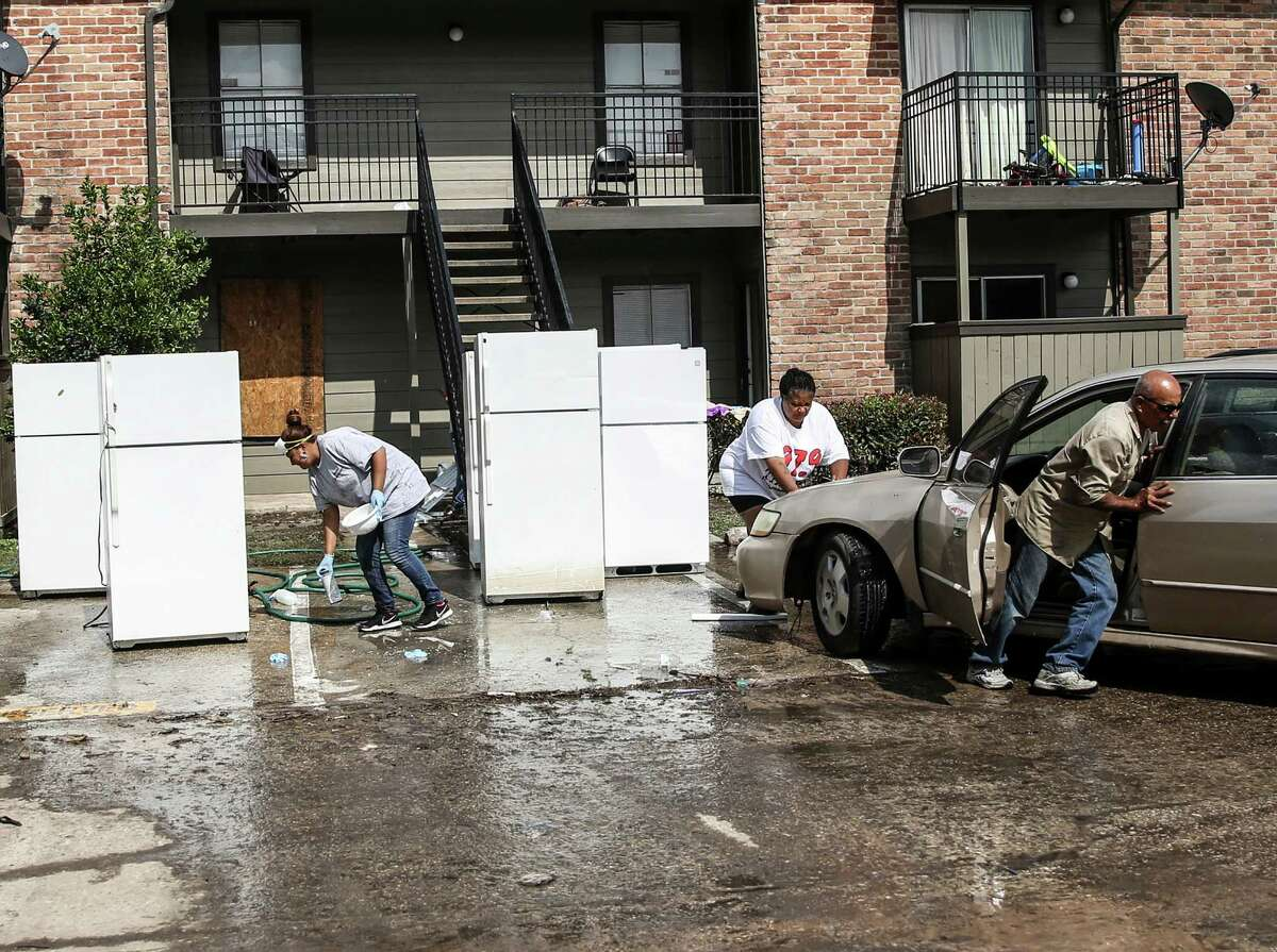 Cleanup continues outside the Salado at Cityview apartment buildings, one of about 17 complexes in the Greenspoint area that flooded in the April 18 storms.