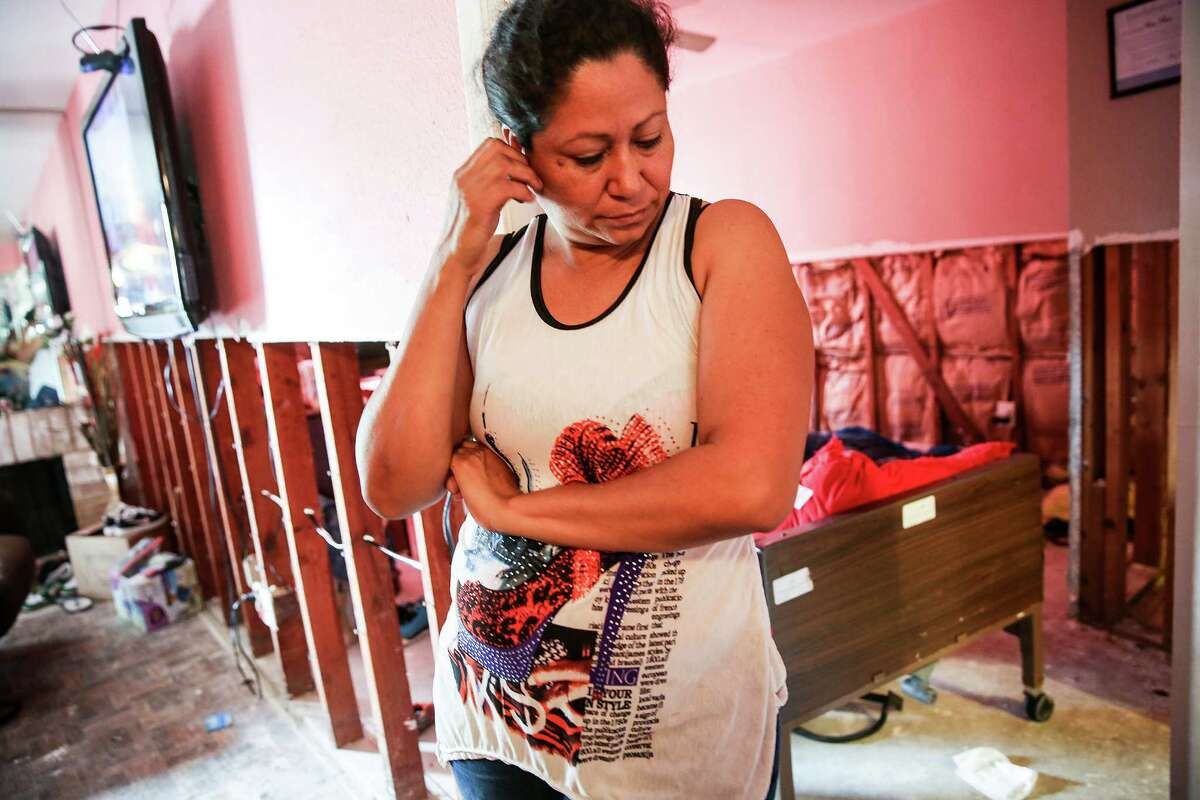 Rosa Ruiz worries that her children would be sickened by the mold in their flooded Maison de Ville apartment, but she says she cannot afford to leave.
