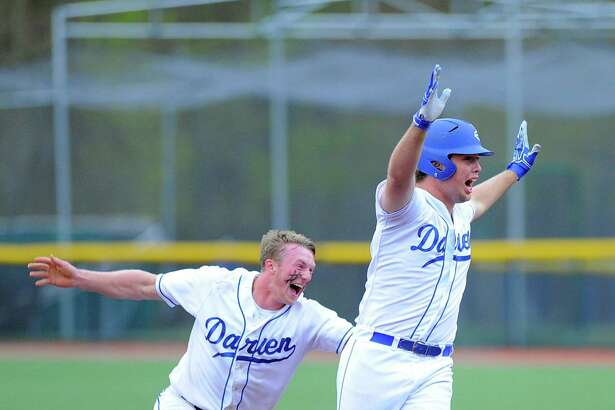 Darien's Mark Scmidt, left, and Casey Brown celebrate Brown's game-winning hit in the bottom of the eighth inning that lifted the Blue Wave over NFA.
