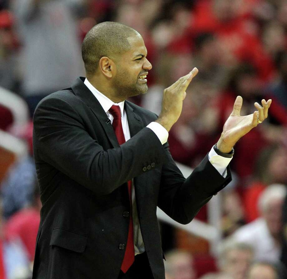 Houston Rockets head coach J.B. Bickerstaff cheers for his team during a timeout against the San Antonio Spurs in the second half of an NBA game played on Christmas Day at the Toyota Center Friday, Dec. 25, 2015, in Houston. Rockets won 88-84. ( Gary Coronado / Houston Chronicle ) Photo: Gary Coronado, Staff / © 2015 Houston Chronicle
