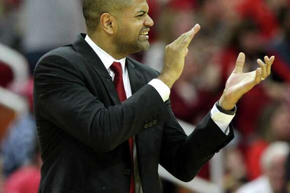 Houston Rockets head coach J.B. Bickerstaff cheers for his team during a timeout against the San Antonio Spurs in the second half of an NBA game played on Christmas Day at the Toyota Center Friday, Dec. 25, 2015, in Houston. Rockets won 88-84. ( Gary Coronado / Houston Chronicle )