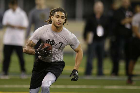 Notre Dame's Will Fuller runs a drill during Notre Dame's NFL football Pro Day in South Bend, Ind., Thursday, March 31, 2016. (AP Photo/Michael Conroy)