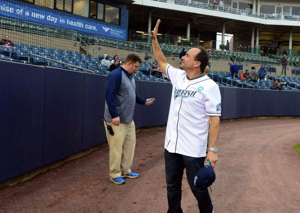 Mayor Joe Ganim waves to fans before the start of the opening day of baseball action between the Bridgeport Bluefish and the New Britain Bees at the Ballpark at Harbor Yard in Bridgeport, Conn., on Thursday Apr. 28, 2016.