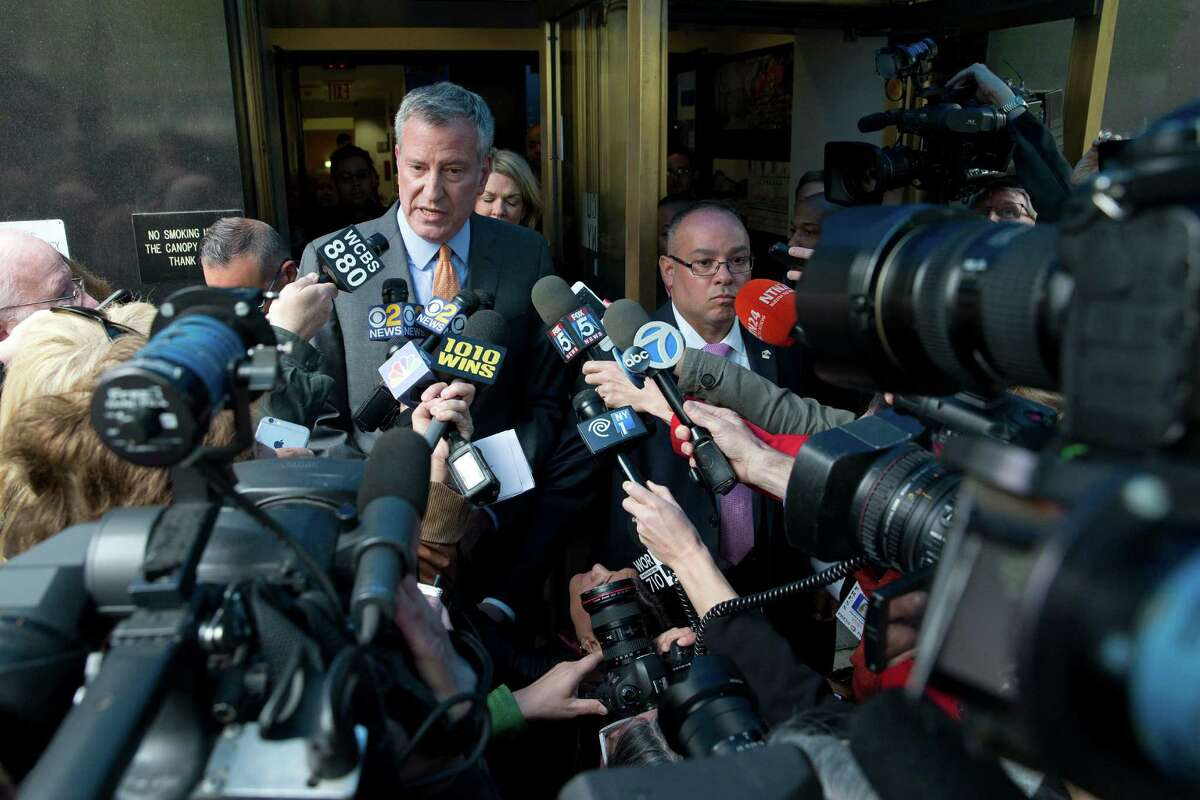 New York City Mayor Bill de Blasio is surrounded by reporters as he leaves an event, Thursday, April 28, 2016, in New York. Aides to de Blasio have been subpoenaed by state and federal prosecutors amid investigations into his campaign fundraising operation, his administration said. (AP Photo/Mary Altaffer) ORG XMIT: NYMA101