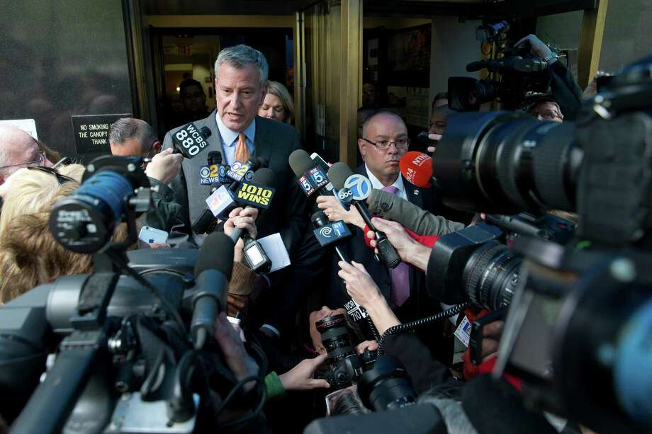 New York City Mayor Bill de Blasio is surrounded by reporters as he leaves an event, Thursday, April 28, 2016, in New York. Aides to de Blasio have been subpoenaed by state and federal prosecutors amid investigations into his campaign fundraising operation, his administration said. (AP Photo/Mary Altaffer) ORG XMIT: NYMA101 Photo: Mary Altaffer / Copyright 2016 The Associated Press. All rights reserved. This m