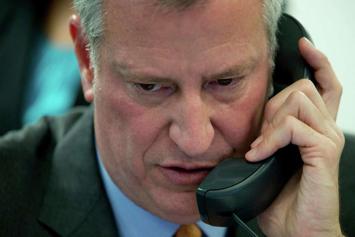 New York City Mayor Bill de Blasio takes a phone call during the 14th Annual CUNY/Daily News Citizenship NOW! event, Thursday, April 28, 2016, in New York. Aides to de Blasio have been subpoenaed by state and federal prosecutors amid investigations into his campaign fundraising operation, his administration said. (AP Photo/Mary Altaffer) ORG XMIT: NYMA104