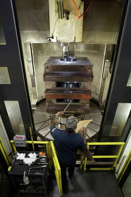 A machinist at Houston-based National Oilwell Varco works on a part for a blowout preventer. Photo: Melissa Phillip, Staff / © 2013  Houston Chronicle