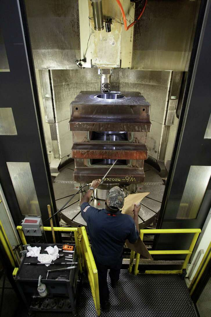 A machinist at Houston-based National Oilwell Varco works on a part for a blowout preventer.