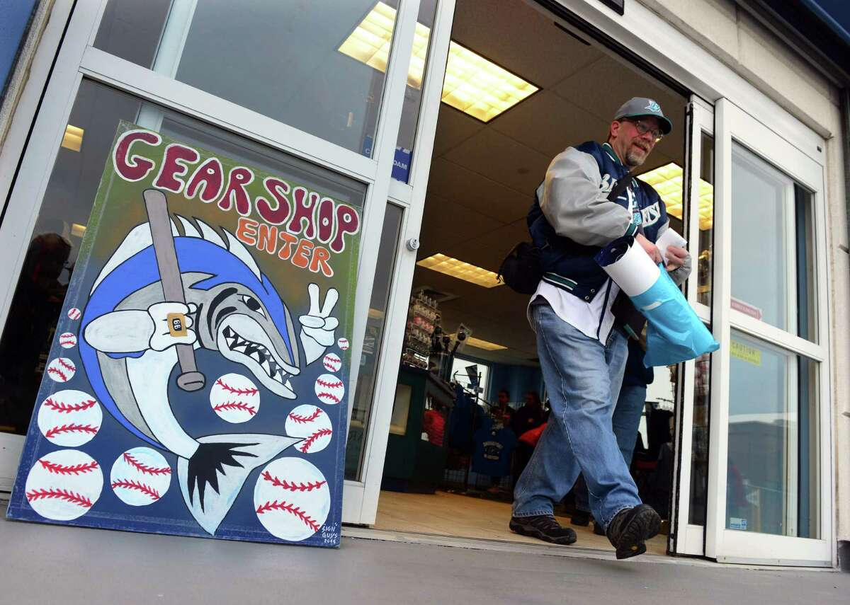 Jim Barr, of Bridgeport, exits the gear shop before the start of opening day baseball action between the Bridgeport Bluefish and the New Britain Bees at the Ballpark at Harbor Yard in Bridgeport, Conn., on Thursday Apr. 28, 2016.