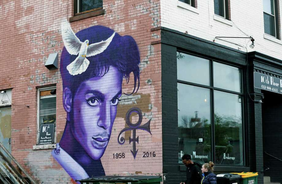 A mural honoring the late rock star Prince adorns a building in the Uptown area of Minneapolis Thursday, April 28, 2016, Prince died last week at his Paisley Park home at the age of 57. An investigation into his death continues. (AP Photo/Jim Mone) ORG XMIT: MP101 Photo: Jim Mone / Copyright 2016 The Associated Press. All rights reserved. This m