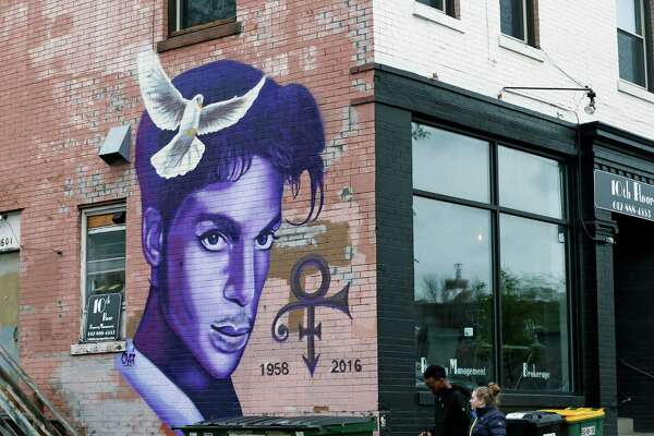 A mural honoring the late rock star Prince adorns a building in the Uptown area of Minneapolis Thursday, April 28, 2016, Prince died last week at his Paisley Park home at the age of 57. An investigation into his death continues. (AP Photo/Jim Mone) ORG XMIT: MP101