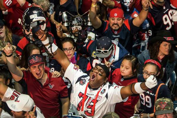 Houston Texans fans react to the Texans selection of Notre Dame wide receiver Will Fuller during the Texans draft party at NRG Stadium on Thursday, April 28, 2016, in Houston. The Texans traded up to take Fuller with the 21st pick overall.