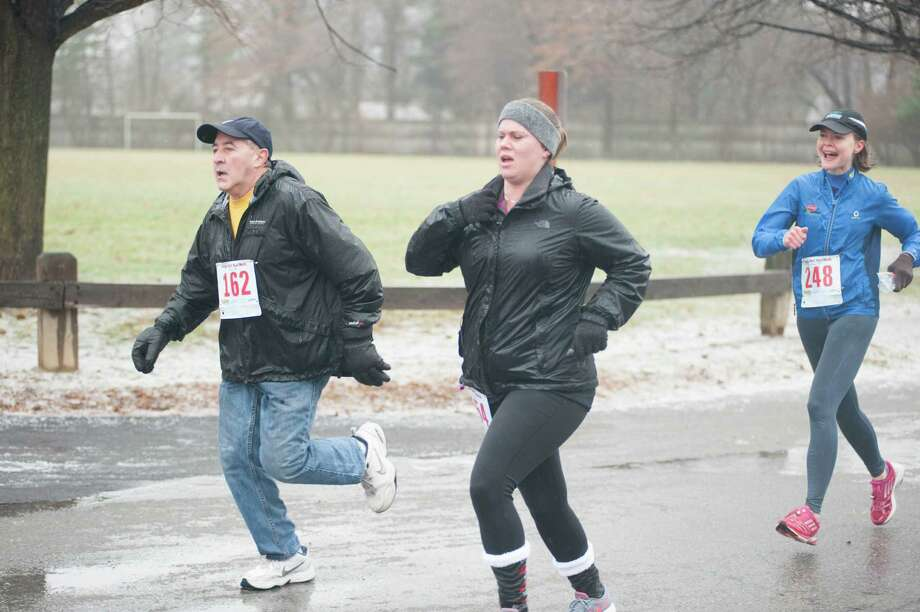 Summer Smith finishing her first 5K in December 2014. Jennifer Gish, president of Strong Through Every Mile and a Times Union editor and writer, is running behind her. Summer, who fought 12 years for recovery, died in her sleep at the YWCA of Northeastern New York in January 2015. Her mother, Kristin Hoin, has organized the Summer Smith 5k Addiction Awareness Memorial Run for May 14 in her honor and to raise funds and awareness about drug addiction. Learn more at summersmith5k.com. (Allison L. Bradley)