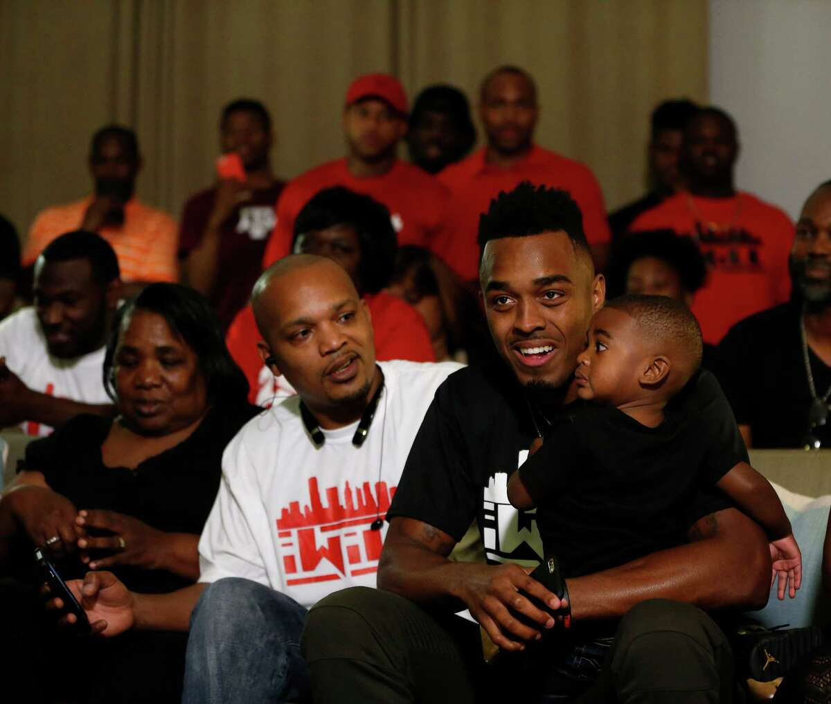 University of Houston's William Jackson III reacts as he holds his nephew, Kamari Martin, 2, after being selected by the Cincinnati Bengals during his NFL Draft party watch at the Westin Oaks in the Galleria, Thursday, April 28, 2016, in Houston.