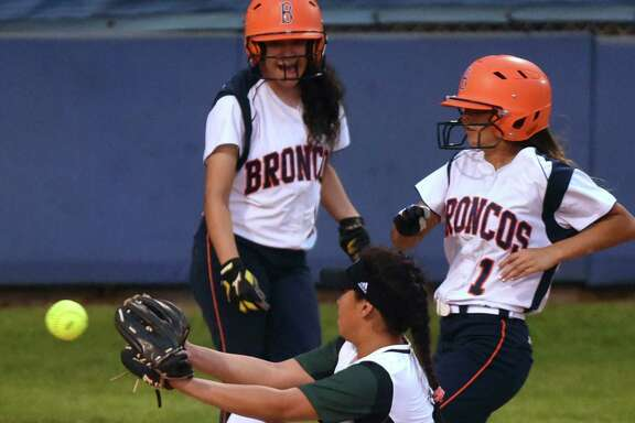 Samantha Corpus of Brandeis scores after a wild pitch as Southwest's Deja Devonie S. Tapia covers home during Class 6A bidistrict softball action at the SAISD Sports Complex on Thursday, April 28, 2016.