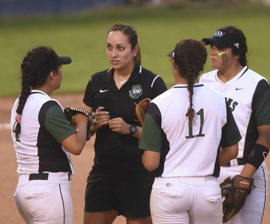 Southwest softball coach Sandra Hernandez speaks with her team on the mound during Class 6A bidistrict softball action against Brandeis at the SAISD Sports Complex on Thursday, April 28, 2016. Photo: Billy Calzada /Staff Photographer / San Antonio Express-News