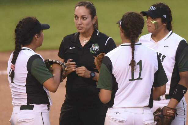 Southwest softball coach Sandra Hernandez speaks with her team on the mound during Class 6A bidistrict softball action against Brandeis at the SAISD Sports Complex on Thursday, April 28, 2016.