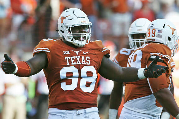 Longhorn defensive tackle Hassan Ridgeway celebrates a sack as Texas hosts Oklahoma State at DKR Stadium  on September 26, 2015.
