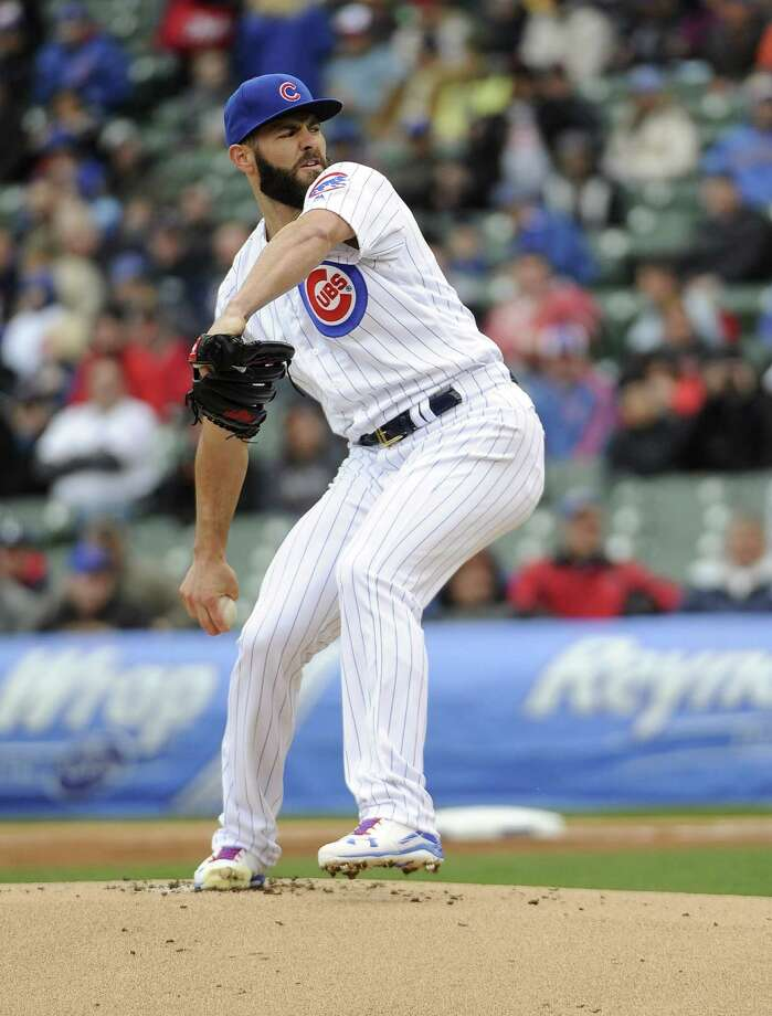 CHICAGO, IL - APRIL 28: Jake Arrieta #49 of the Chicago Cubs pitches against the Milwaukee Brewers during the first inning on April 28, 2016 at Wrigley Field in Chicago, Illinois.  (Photo by David Banks/Getty Images) ORG XMIT: 607676591 Photo: David Banks / 2016 Getty Images