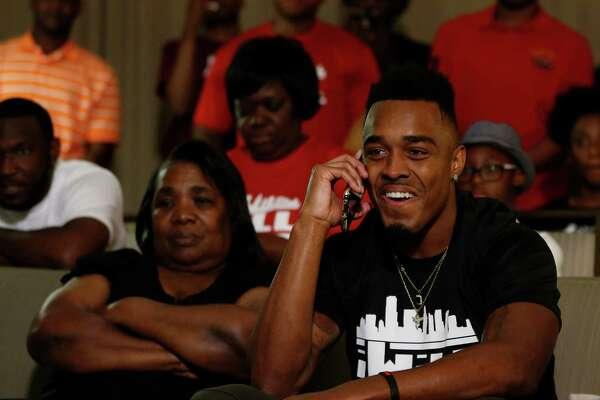 Surrounded by family, UH's William Jackson III gets the news from the Bengals that they made him their first-round pick Thursday night.