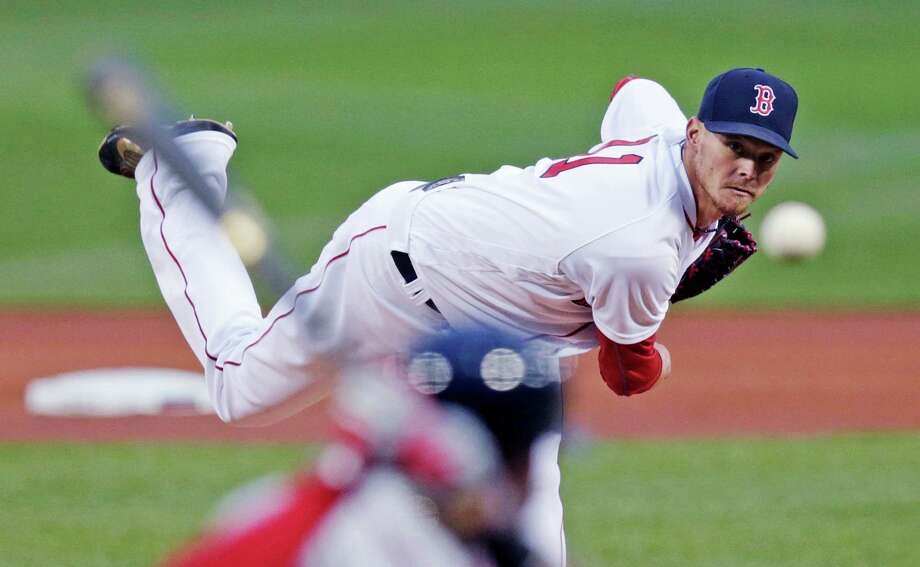 Boston Red Sox starting pitcher Clay Buchholz delivers during the first inning of a baseball game against the Atlanta Braves at Fenway Park in Boston, Thursday, April 28, 2016. (AP Photo/Charles Krupa) ORG XMIT: MACK102 Photo: Charles Krupa / Copyright 2016 The Associated Press. All rights reserved. This m