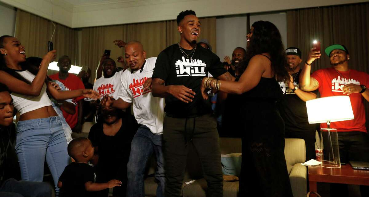 University of Houston's William Jackson III reacts after he was selected by the Cincinnati Bengals during his NFL Draft party watch at the Westin Oaks in the Galleria, Thursday, April 28, 2016, in Houston.