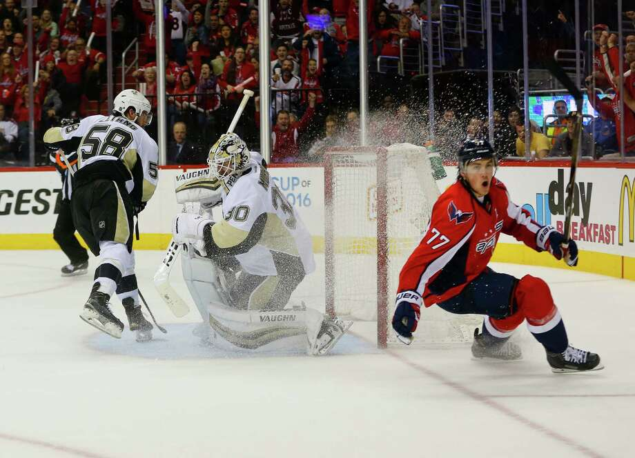 Washington Capitals right wing T.J. Oshie (77) starts to celebrate his goal against Pittsburgh Penguins goalie Matt Murray (30) and Kris Letang (58) during the second period of Game 1 in an NHL hockey Stanley Cup Eastern Conference semifinals Thursday, April 28, 2016 in Washington. (AP Photo/Pablo Martinez Monsivais) ORG XMIT: DCPM106 Photo: Pablo Martinez Monsivais / Copyright 2016 The Associated Press. All rights reserved. This m