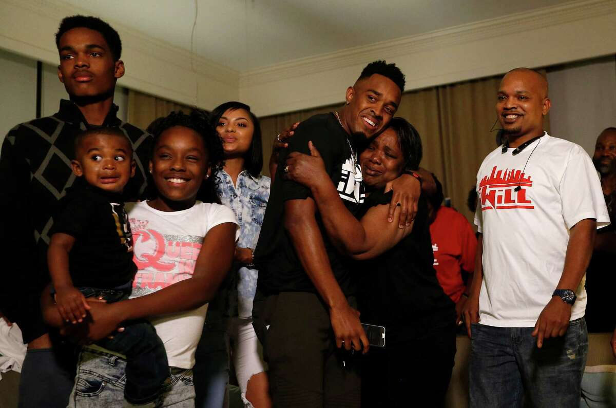 University of Houston's William Jackson III hugs his grand mother, Judy Johnson, after he was selected by the Cincinnati Bengals during his NFL Draft party watch at the Westin Oaks in the Galleria, Thursday, April 28, 2016, in Houston.
