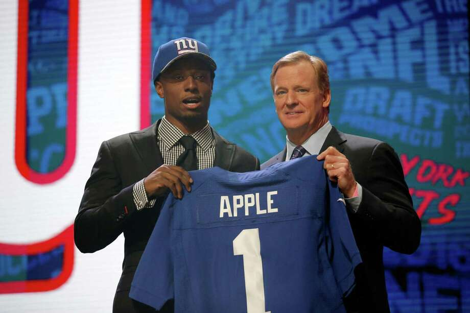 CHICAGO, IL - APRIL 28:  (L-R) Eli Apple of Ohio State holds up a jersey with NFL Commissioner Roger Goodell after being picked #10 overall by the New York Giants during the first round of the 2016 NFL Draft at the Auditorium Theatre of Roosevelt University on April 28, 2016 in Chicago, Illinois.  (Photo by Jon Durr/Getty Images) ORG XMIT: 609385781 Photo: Jon Durr / 2016 Getty Images